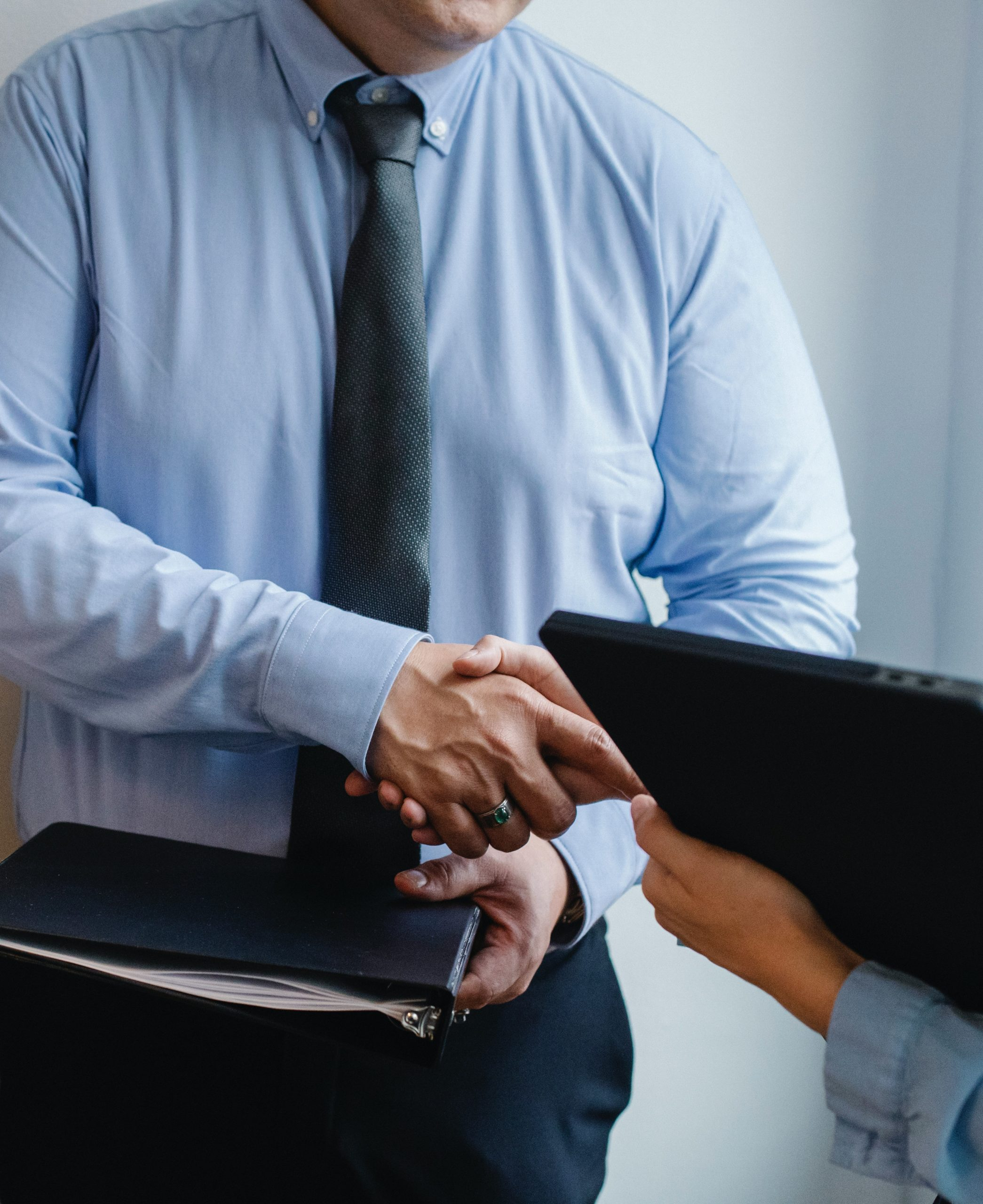 Two business professionals shaking hands.